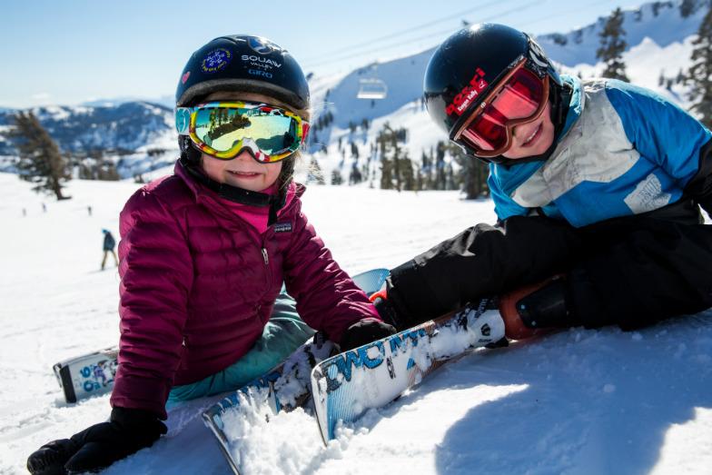 two kids with ski gear