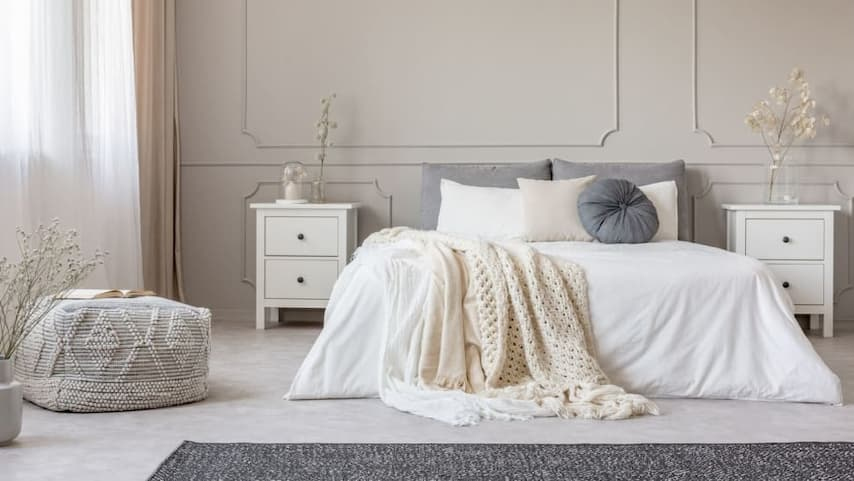 white bamboo bedding with decorative pillows and throws