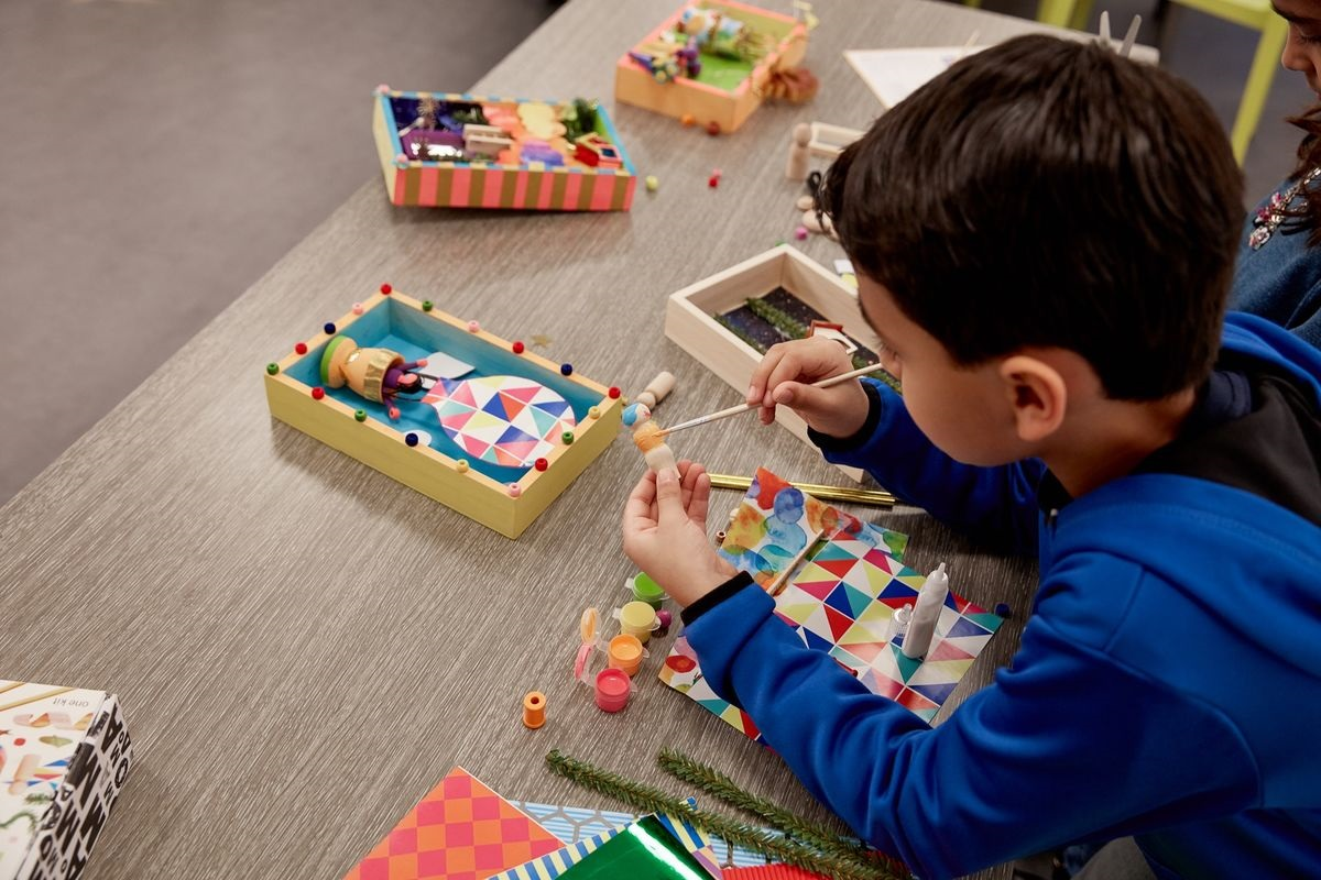kid playing with art kits